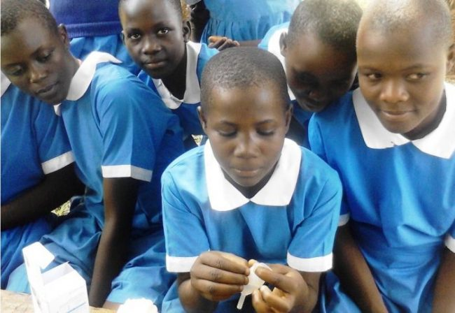 Kenyan school girl shows how to use a Mooncup menstrual cup