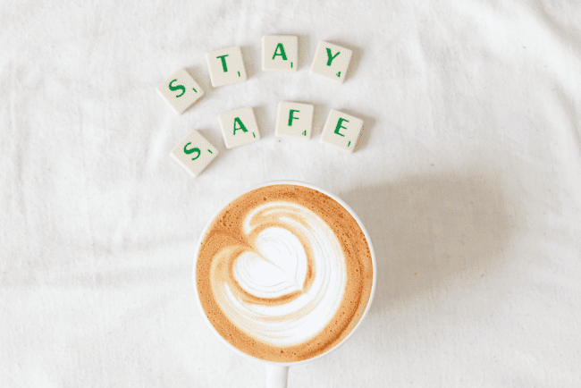 Stay safe letters over a coffee cup