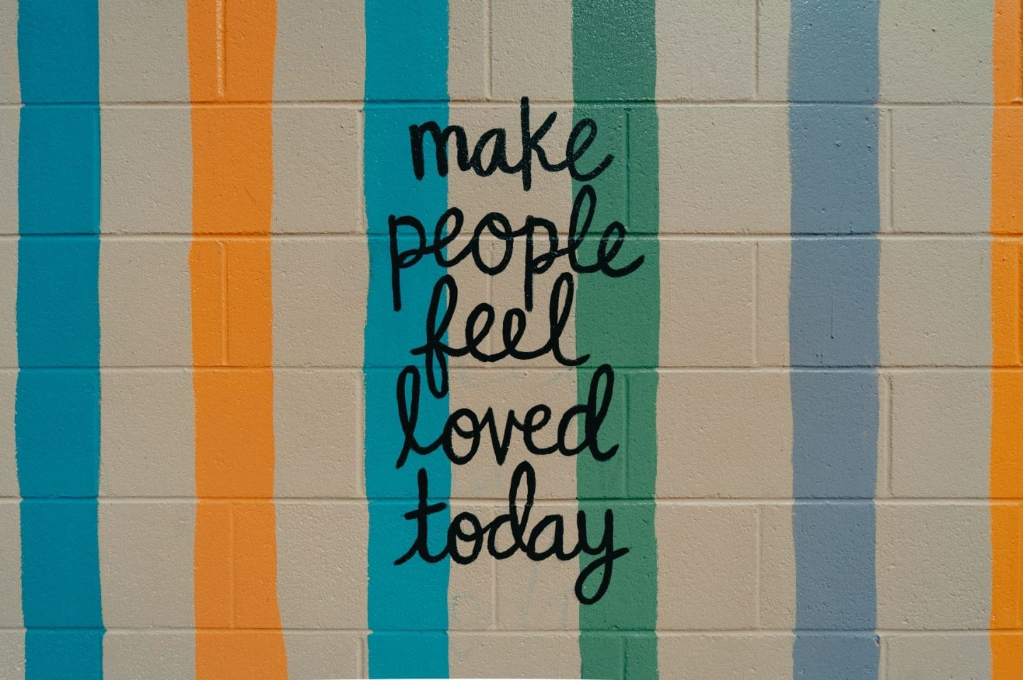 make people feel loved today text on the wall