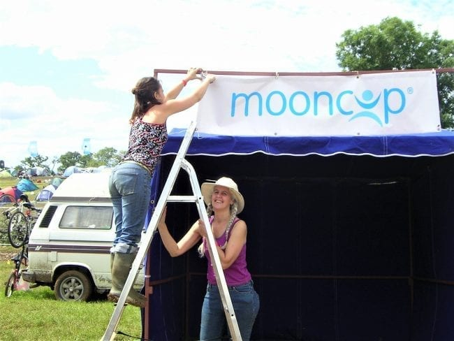 Setting up the Mooncup stall at Glastonbury