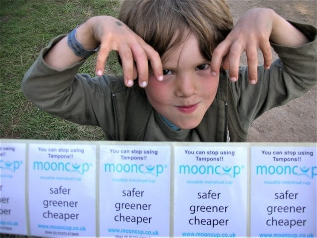 Young boy with Mooncup stickers
